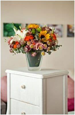 Balsam für die Seele mit buntem Blumenstrauß